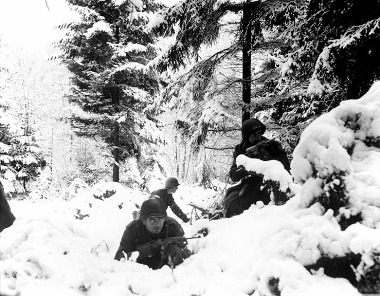 American 290th Infantry Regiment infantrymen fighting in snow during the Battle of the Bulge