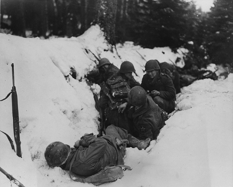 US soldiers take cover from German fire 14 December 1944