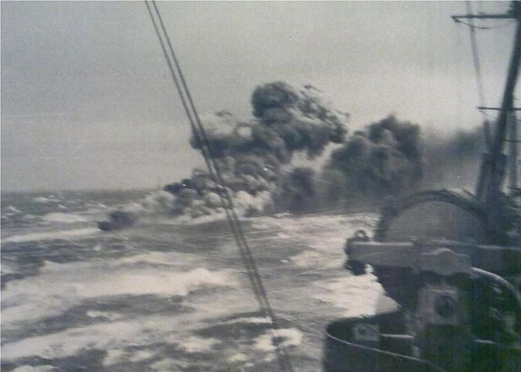 HMS Glowworm in flames after engaging the Admiral Hipper