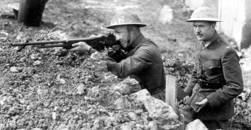 John Browning's son Lt. Val Browning demonstrating his father's gun