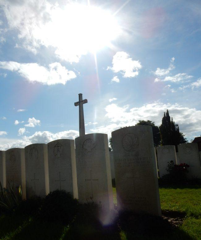 The setting sun over Esquelbecq's Cross of Sacrifice.