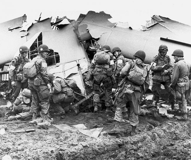 101st Airborne Paratroopers inspect a broken glider.