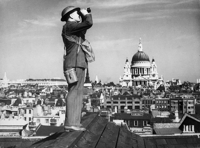 An Observer Corps spotter scans the skies of London during the Battle of Britain.