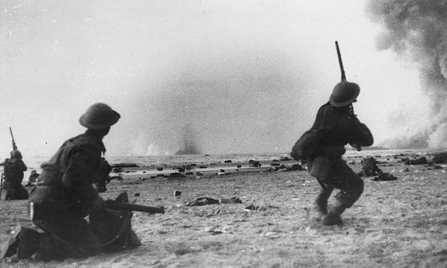 Soldiers from the BEF fire at low flying German aircraft during the Dunkirk evacuation.