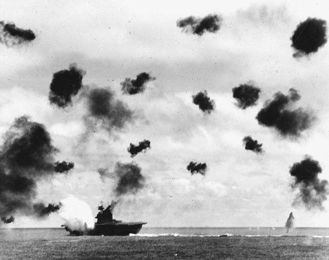 Yorktown at the moment of impact of a torpedo from a Nakajima B5N of Lieutenant Hashimoto's 2nd chūtai.