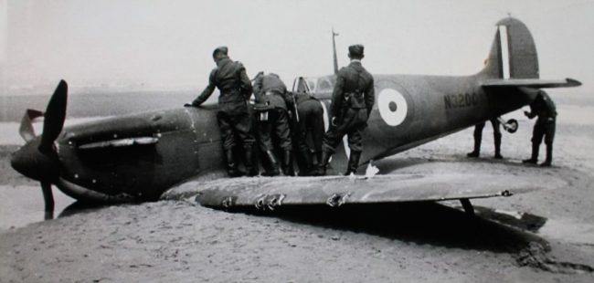Squadron Leader Stephenson's Spitfire, N3200, down on the beach at Sandgatte.