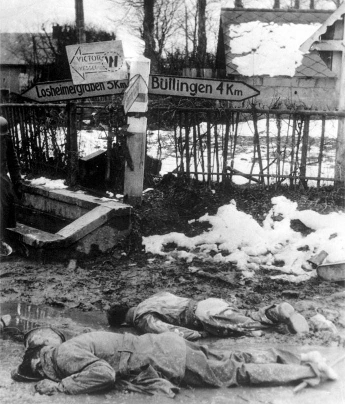 American soldiers lying dead and stripped of equipment in Honsfeld, Belgium, 17 December