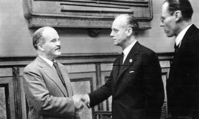 Molotov and Ribbentrop shaking hands after signing the pact.