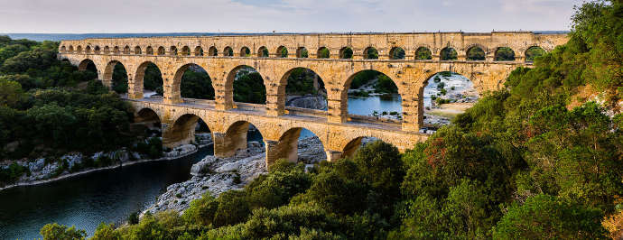 Photograph of the Ancient Roman aqueduct near Nimes, now the Pont du Gard.