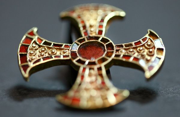 This cross found in a Anglo-Saxon grave shows how important christiany had become to the Saxons by Alfred's time.