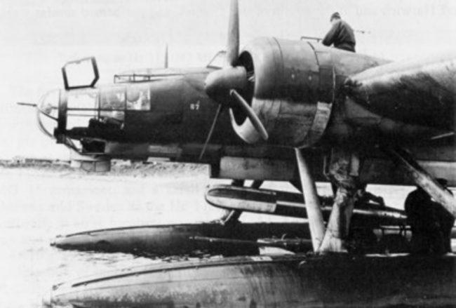 A torpedo is loaded on a German Heinkel He 115 seaplane.