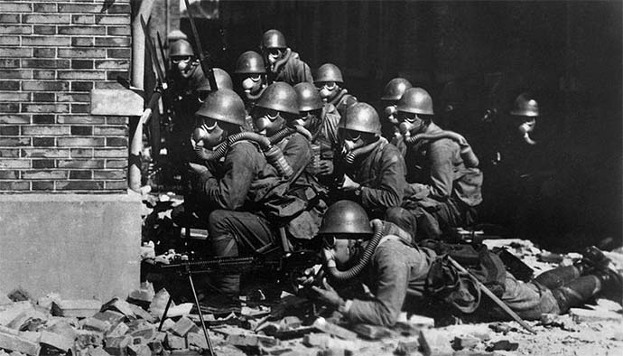 Japanese Special Naval Landing Forces with gas masks and rubber gloves during a chemical attack near Chapei in the Battle of Shanghai.