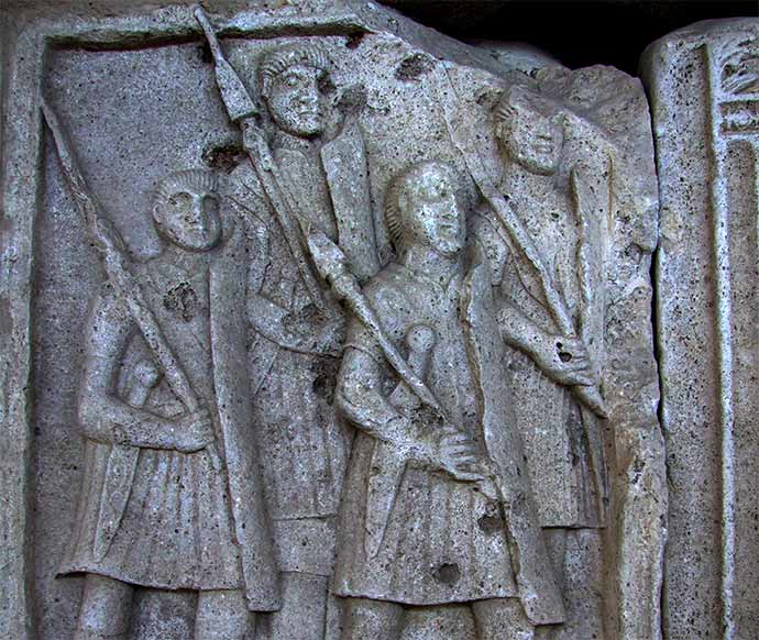 Roman legionnaires holding pilum.